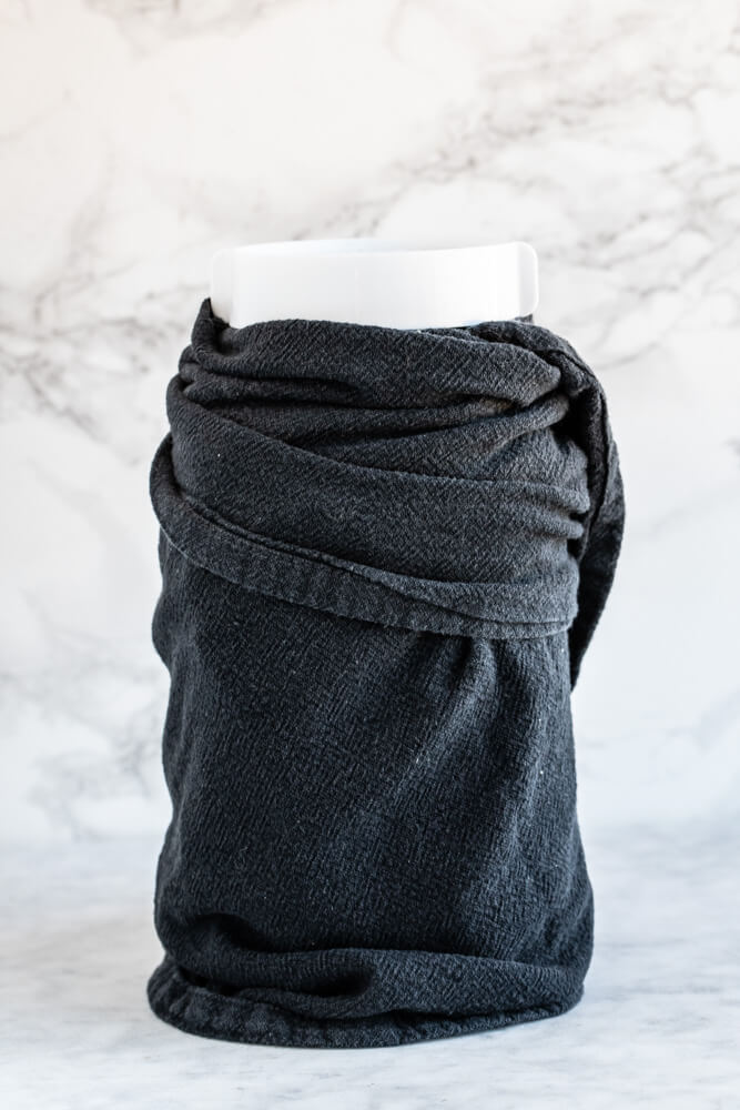 large mason jar wrapped in black towel