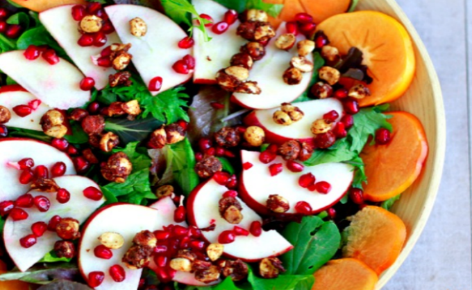 Autumn Salad with Apples, Pomegranates, and Persimmons (with orange vinaigrette and candied hazelnuts)