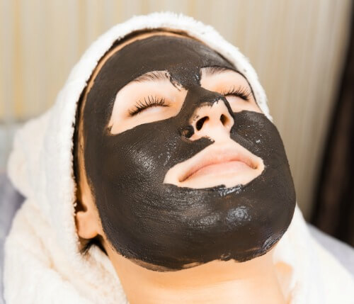 woman with dark mask on her face