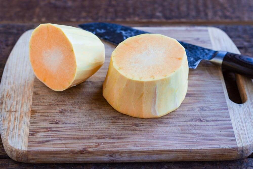 peeled butternut squash on cutting board