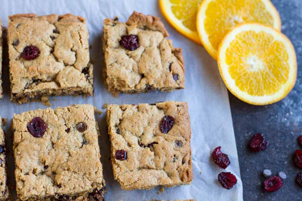 Orange Cranberry Chocolate Chip Cookie Bars (gluten free) || www.savorylotus.com