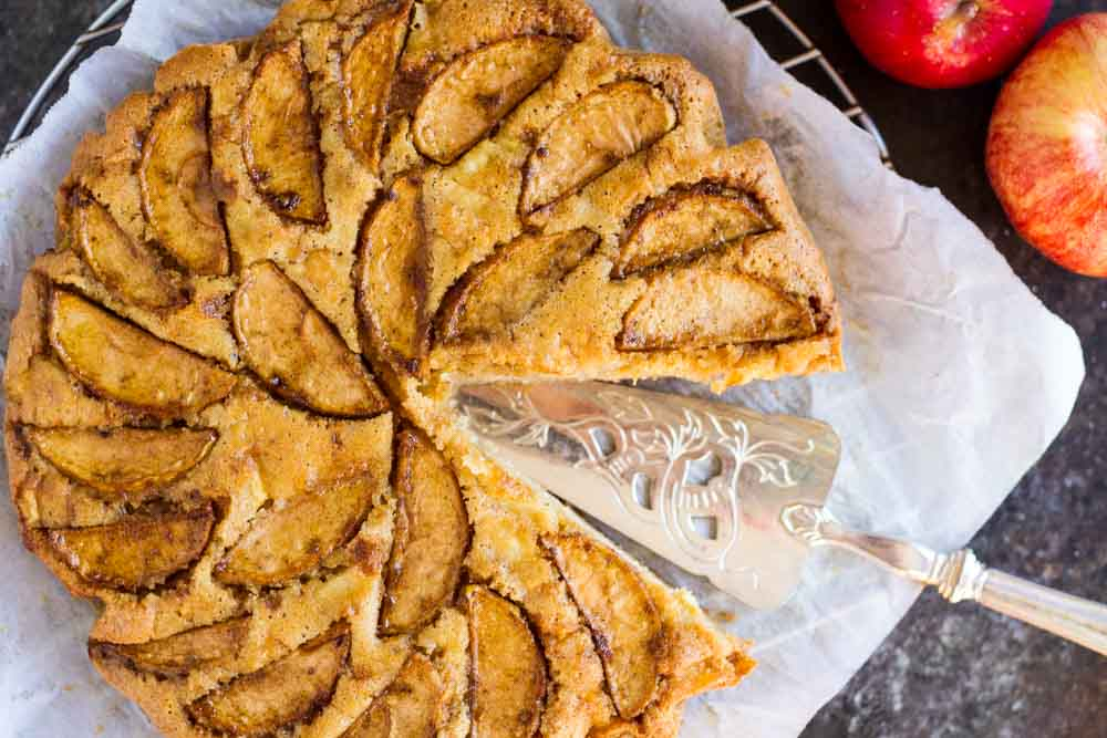 Cardamom Apple Cake on white parchment paper