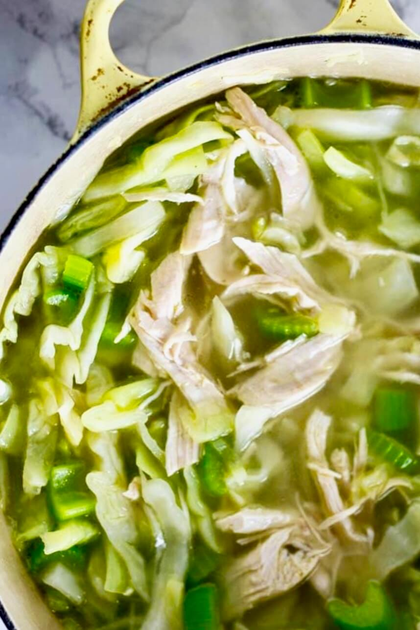 close up of cabbage soup in yellow pot