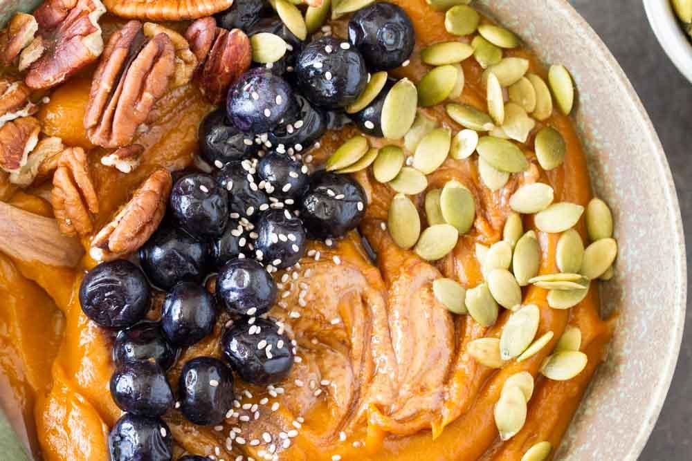 Simple Sweet Potato Breakfast Bowl (gluten free, grain free) close up of pecans, pumpkin seeds, blueberries | www.savorylotus.com