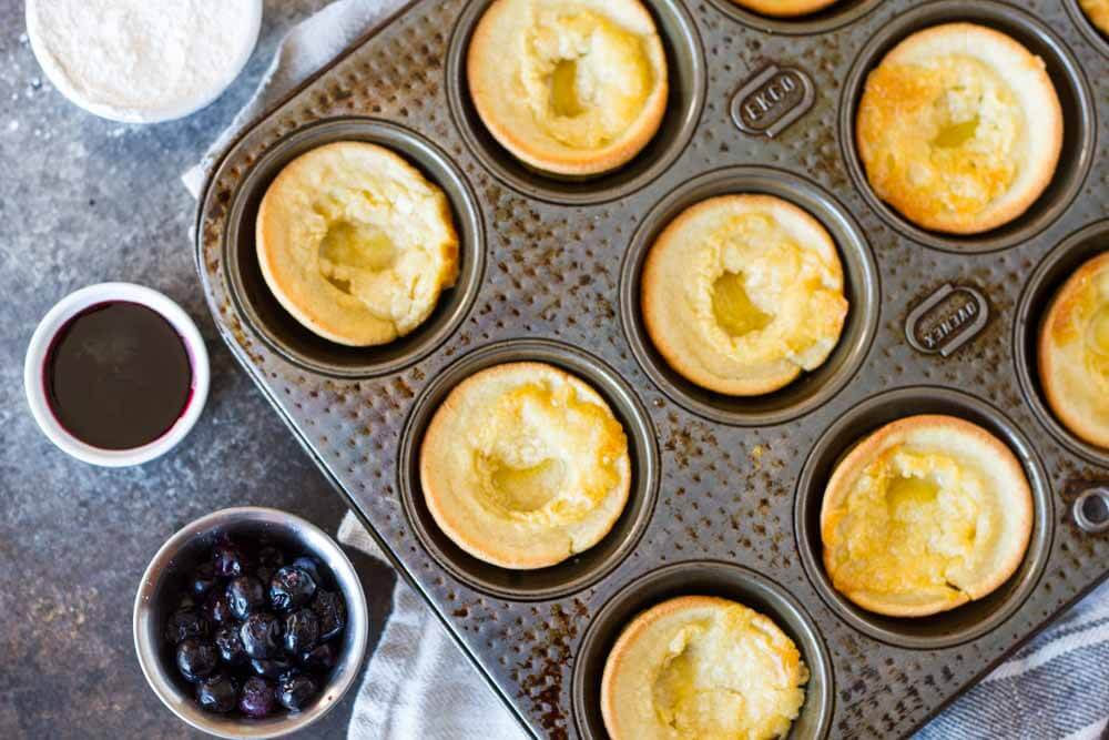 Mini Dutch Babies in a muffin tin