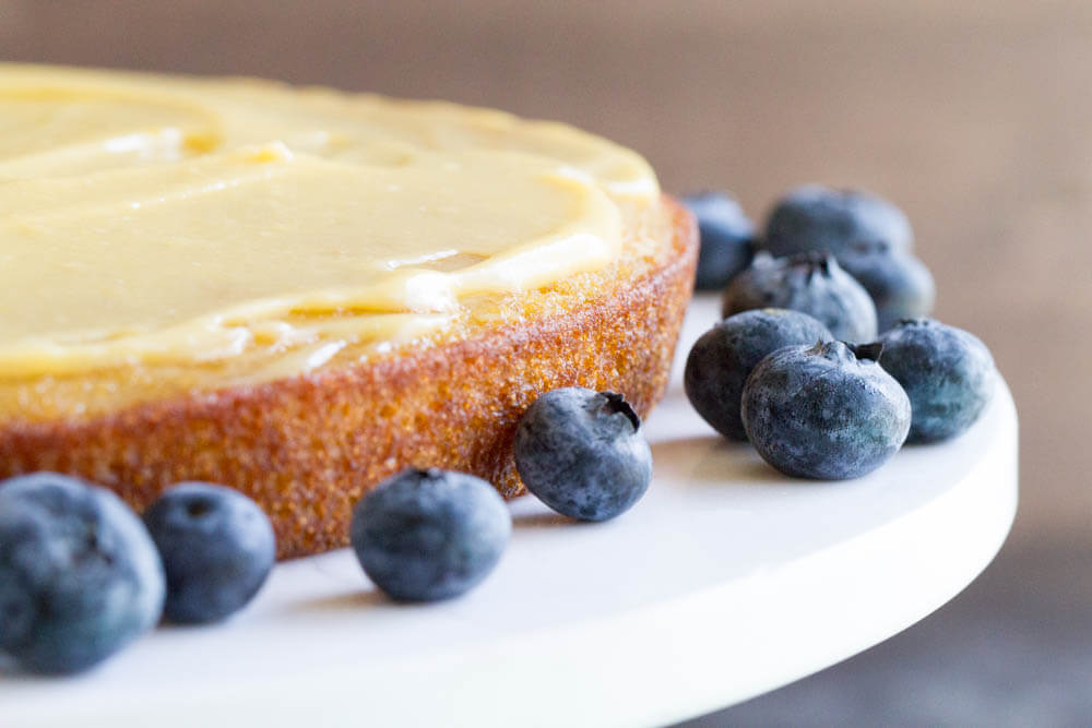 lemon curd and fresh blueberries on yellow cake