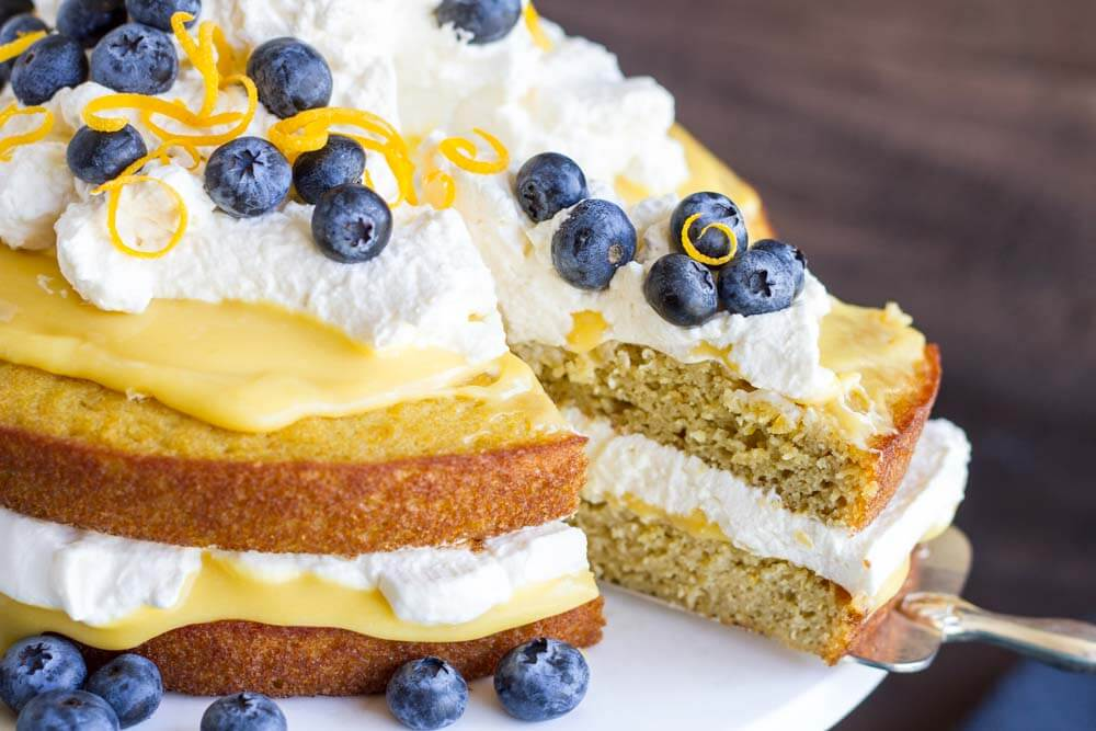 a slice of lemon curd and cream cake