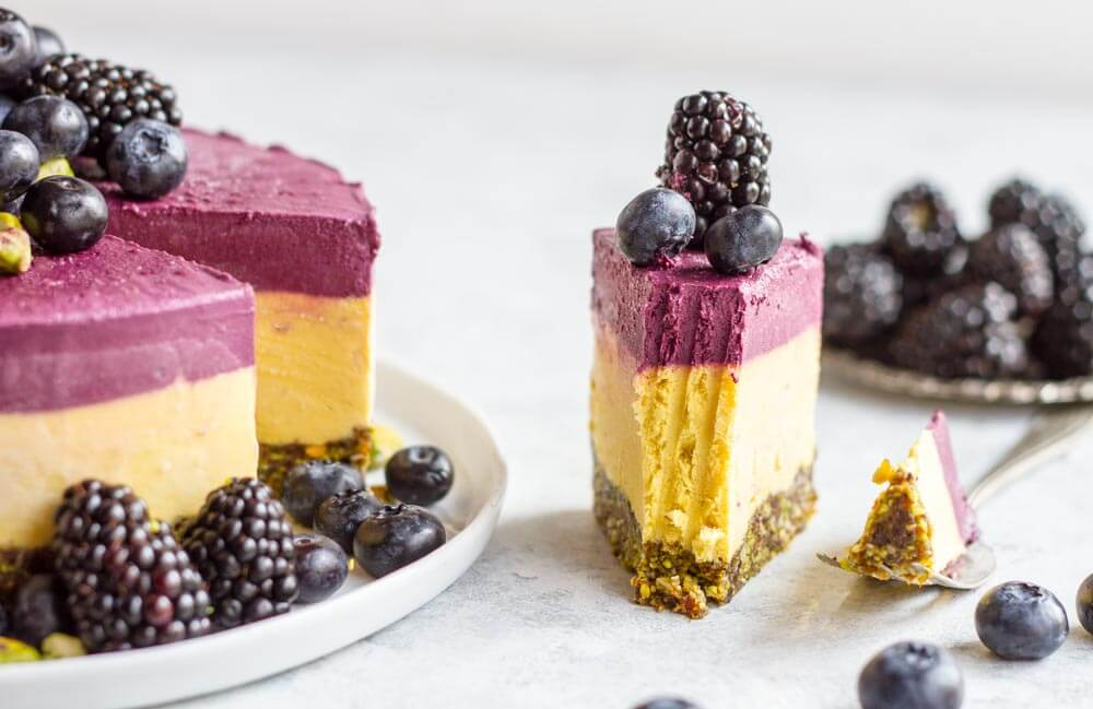 slice of mango blackberry cheesecake with fruit on top