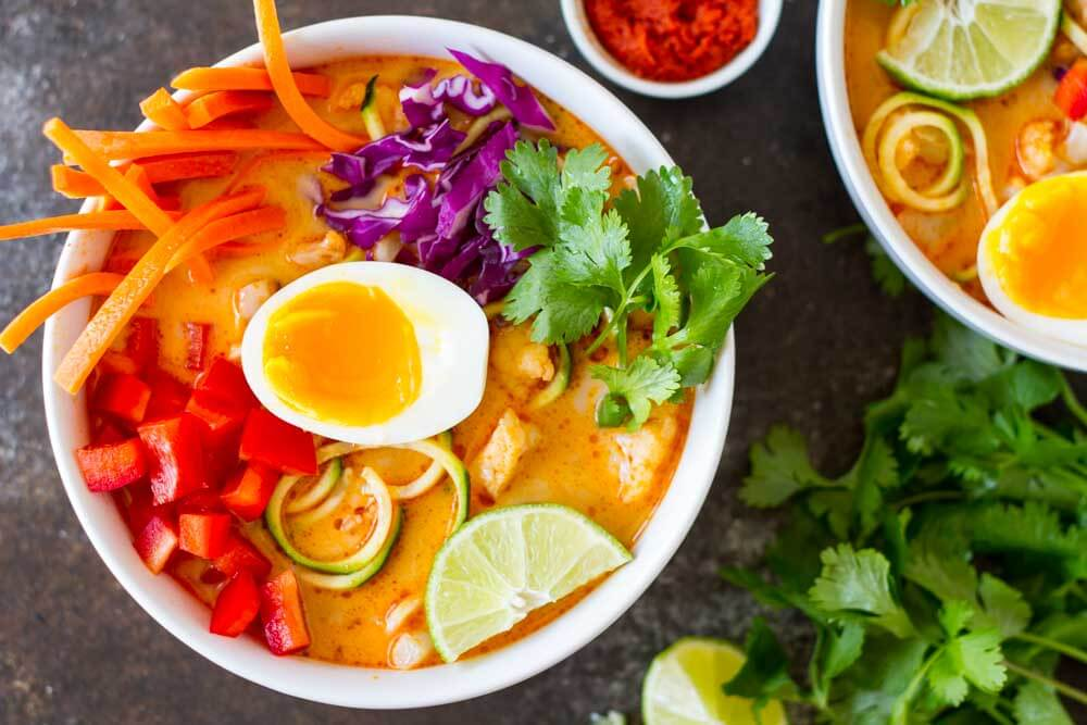 Thai Red Curry Coconut Soup in white bowl