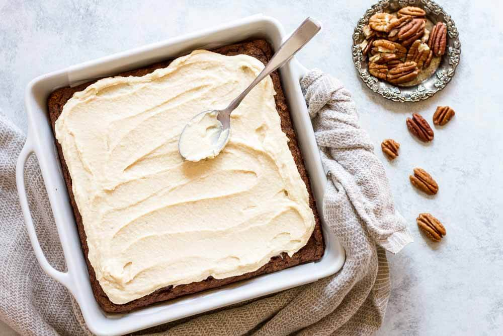 pumpkin cake with white frosting