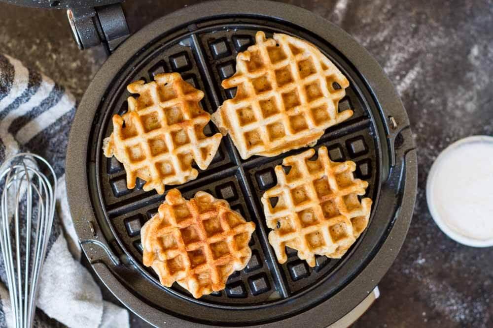 Mini Apple Fritter Waffles in a waffle iron