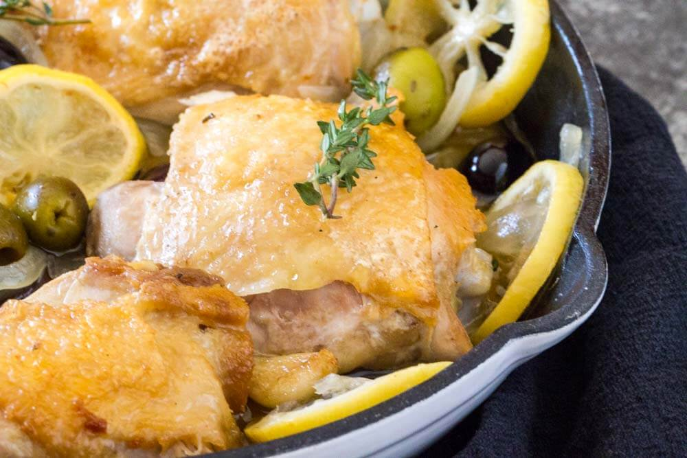 Braised Chicken Thighs with Lemon and Olives in skillet