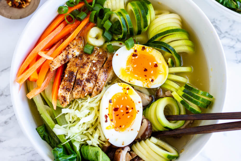 Whole30 Ramen Bowl with sift boiled egg in middle