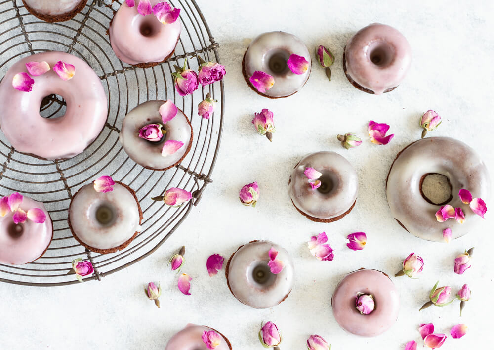 Chocolate Rose Donuts on white table and on wire rack