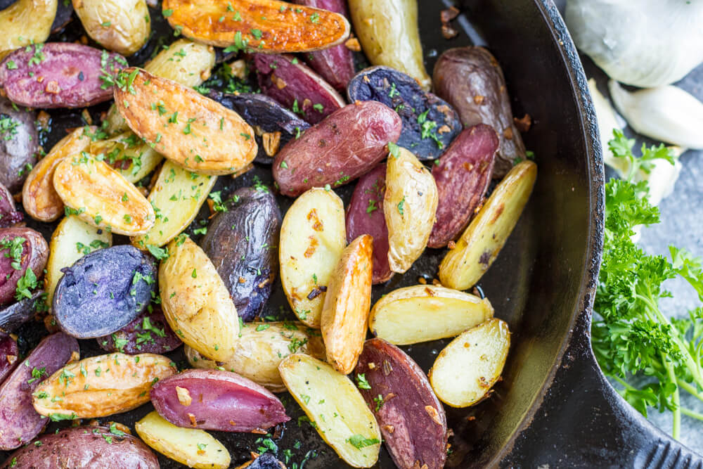 Garlic Roasted Potatoes in cast iron skillet