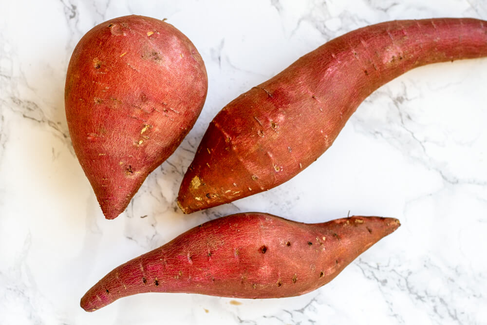 Sweet Potatoes on white marble