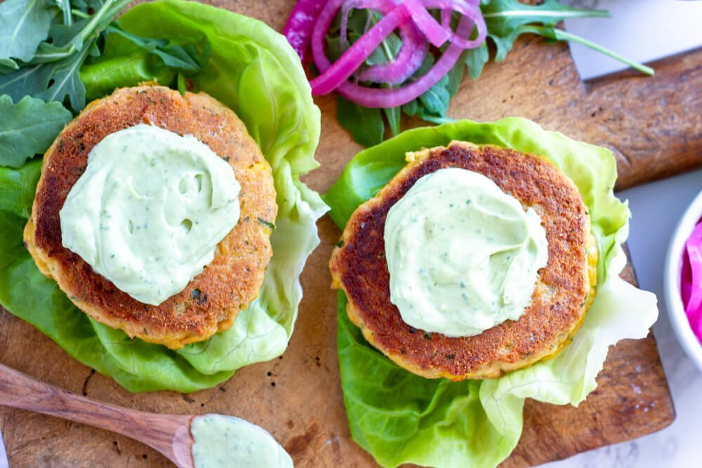 Salmon Burgers with green sauce on top