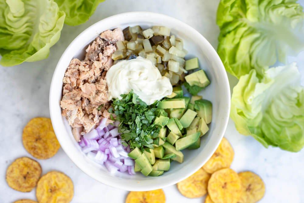 salmon salad ingredients in white bowl