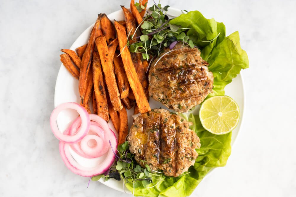 Chili Lime Chicken Burgers and sweet potato fries on white plate
