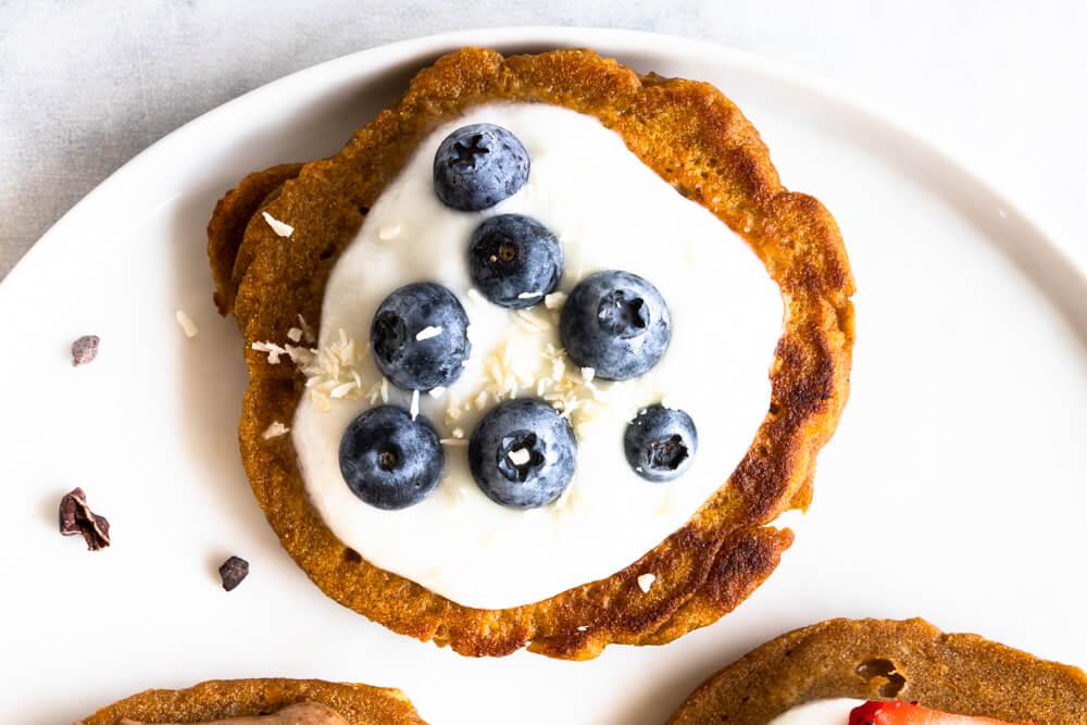Fluffy Sweet Potato Pancakes (gluten free and paleo) -- with blueberries and yogurt