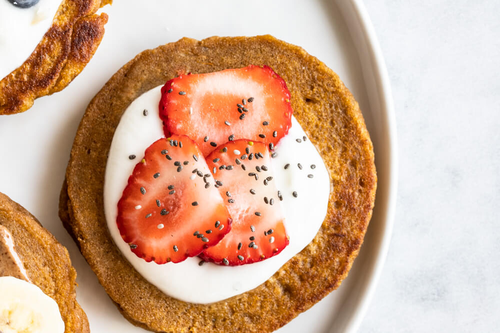 Fluffy Sweet Potato Pancakes (gluten free and paleo) -- with strawberries and yogurt