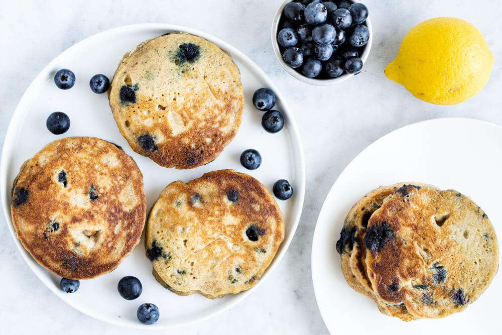 blueberry pancakes on white plate