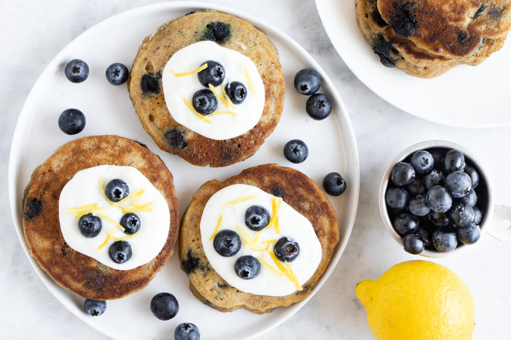 blueberry pancakes with yogurt and berries on top