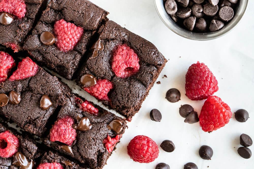 Chocolate Raspberry Brownies  with raspberries on table
