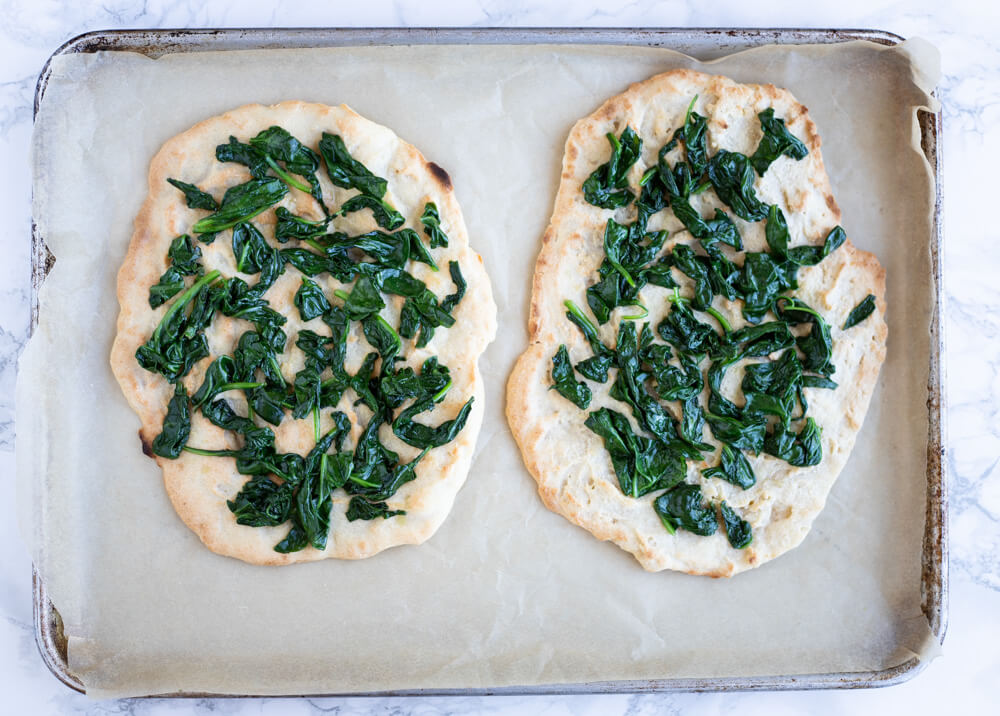 flatbread with spinach on top