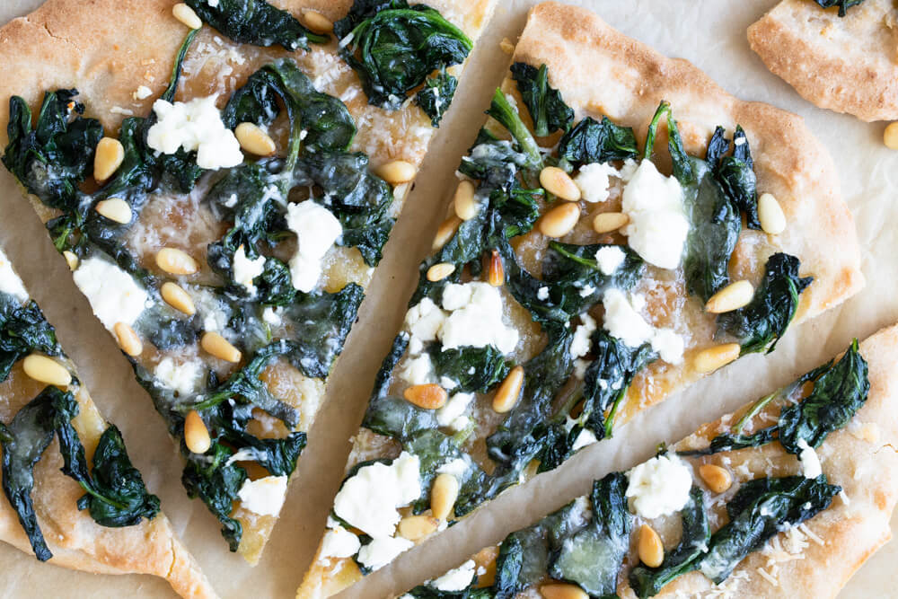 close up of Spinach and Goat Cheese Flatbread Pizza