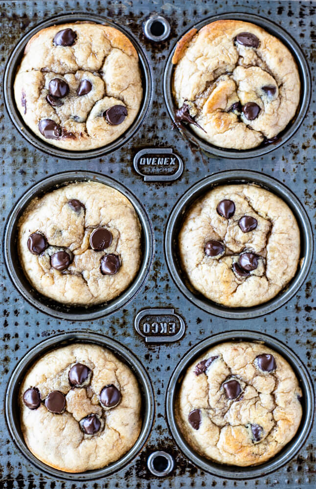6 muffins with chocolate chips in a muffin pan
