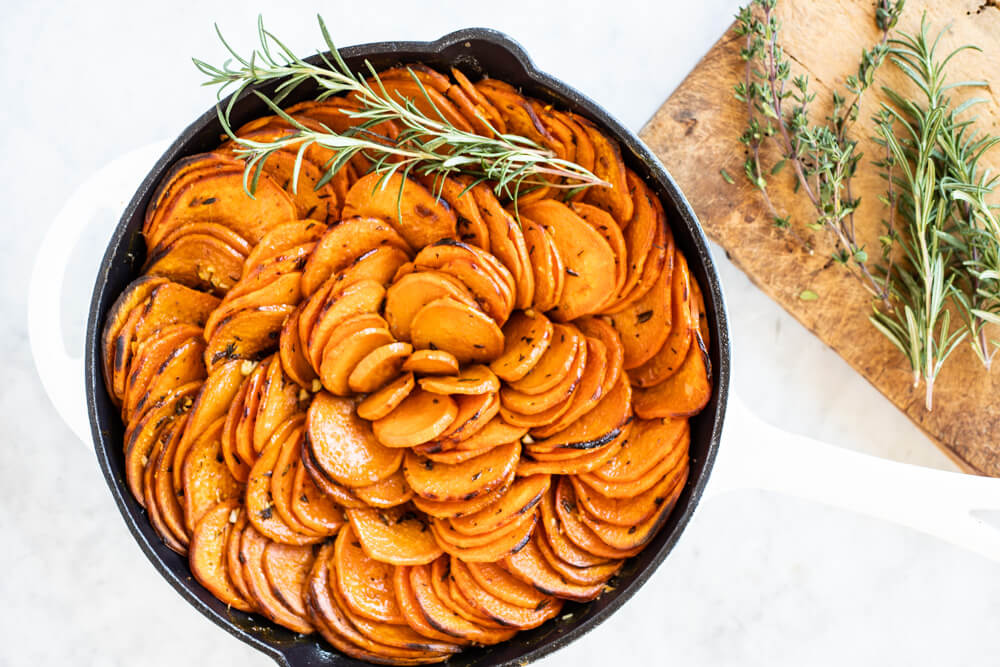 sweet potato slices in white skillet