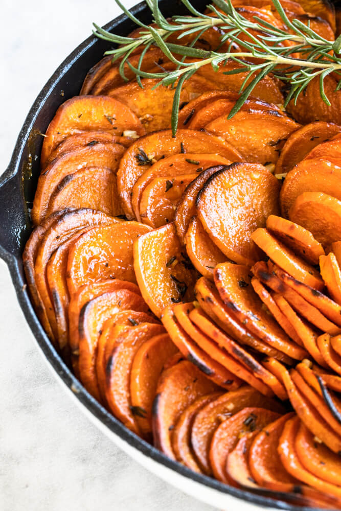 close up of sweet potato slices cooked in butter