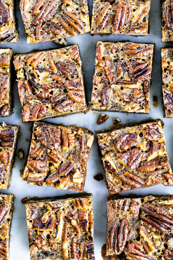 pecan pie bars cut into squares on marble counter
