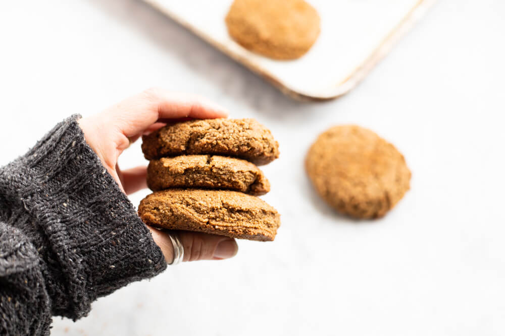 hand holding three gingerbread cookies
