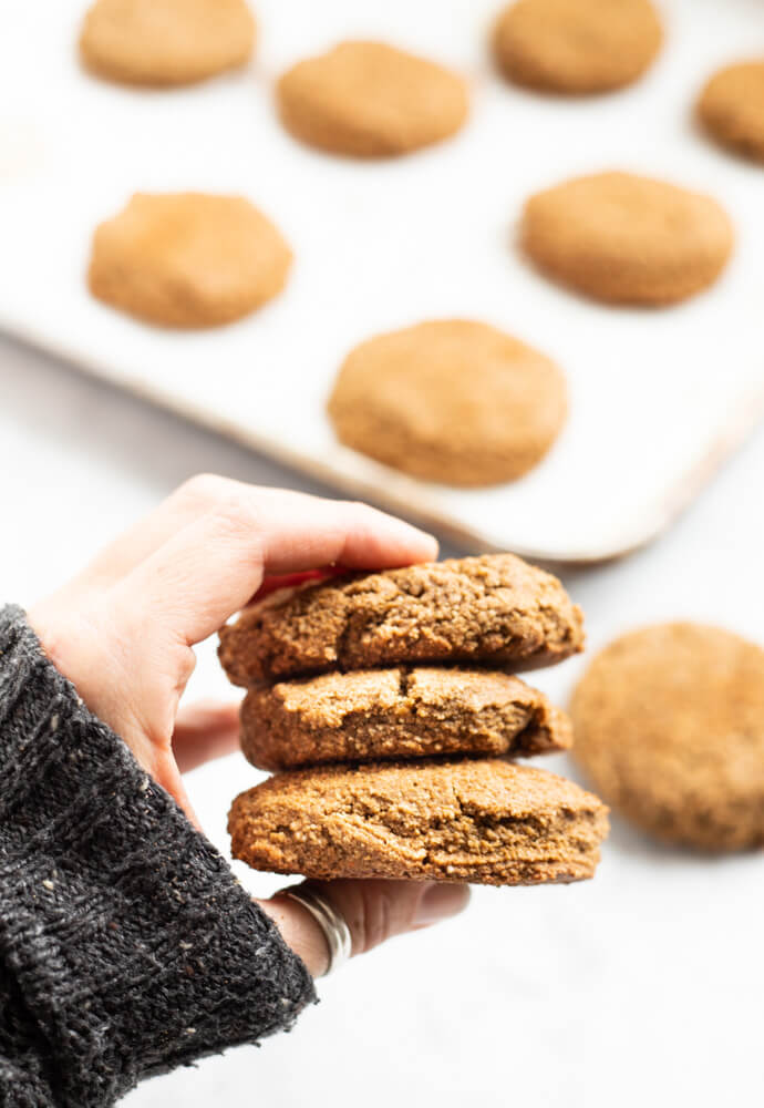 three big gingerbread cookies held in hand