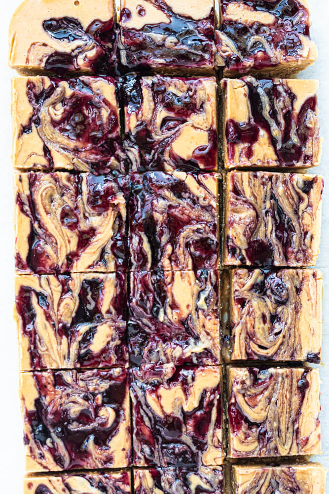 purple jam swirled onto peanut butter bars