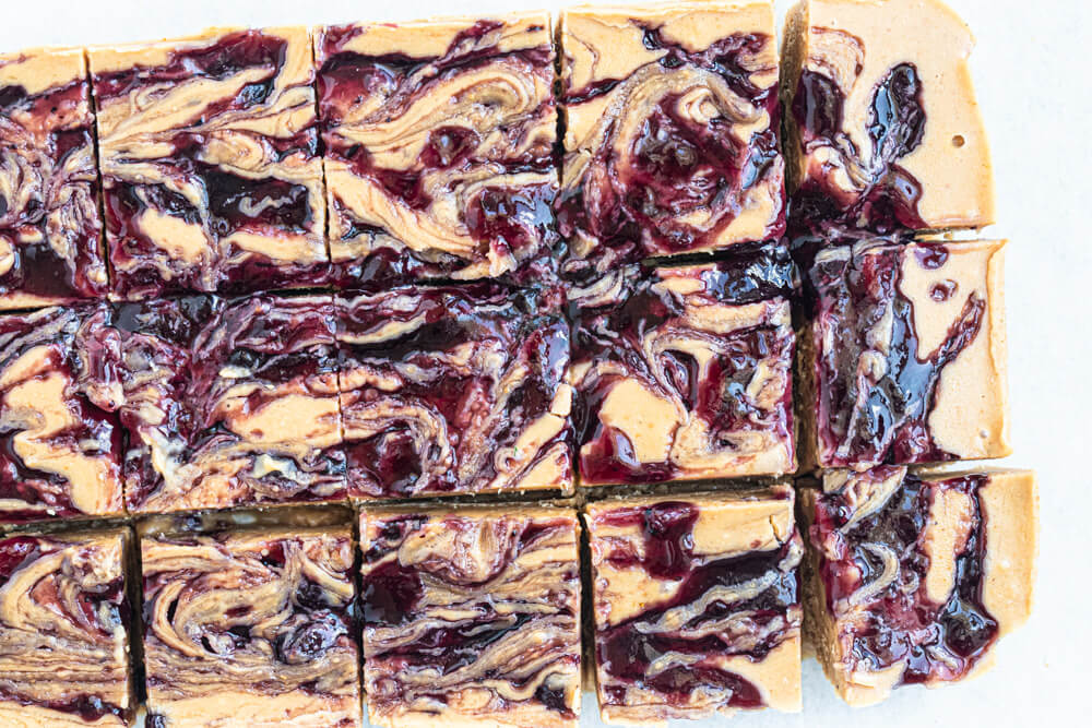 peanut butter and jelly bars cut into squares