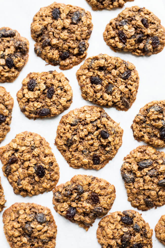 several gluten free oatmeal raisin cookies on white surface