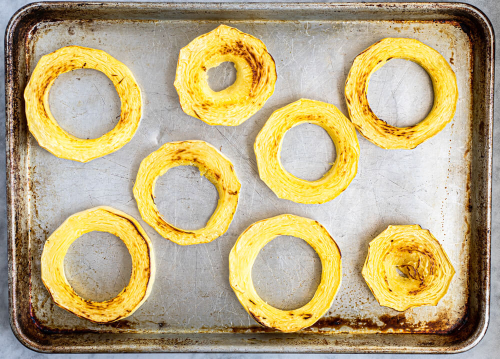 8 rings of spaghetti squash on baking sheet