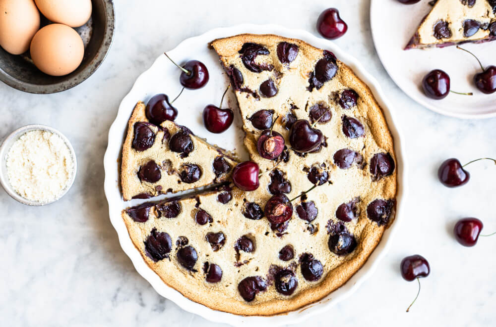 white tart pan with cherry clafoutis
