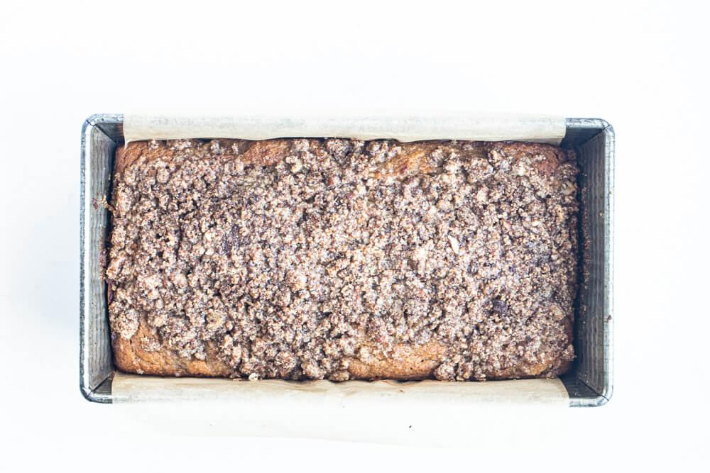 apple bread in a metal loaf pan