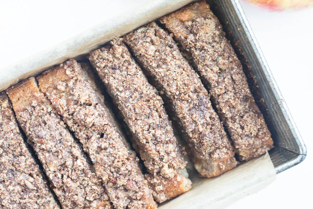 sliced apple bread in metal loaf pan