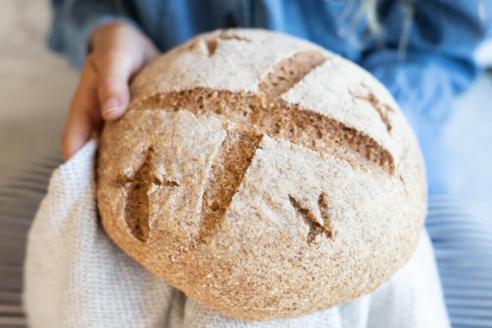 loaf of bread held in white towel