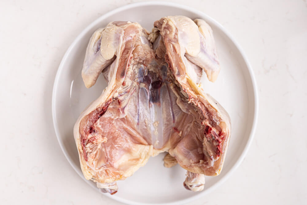 inside of a cut whole chicken