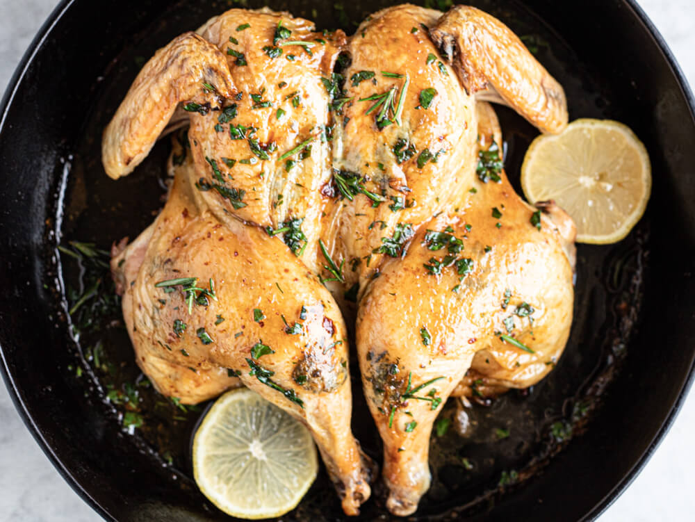 whole roasted chicken in black skillet