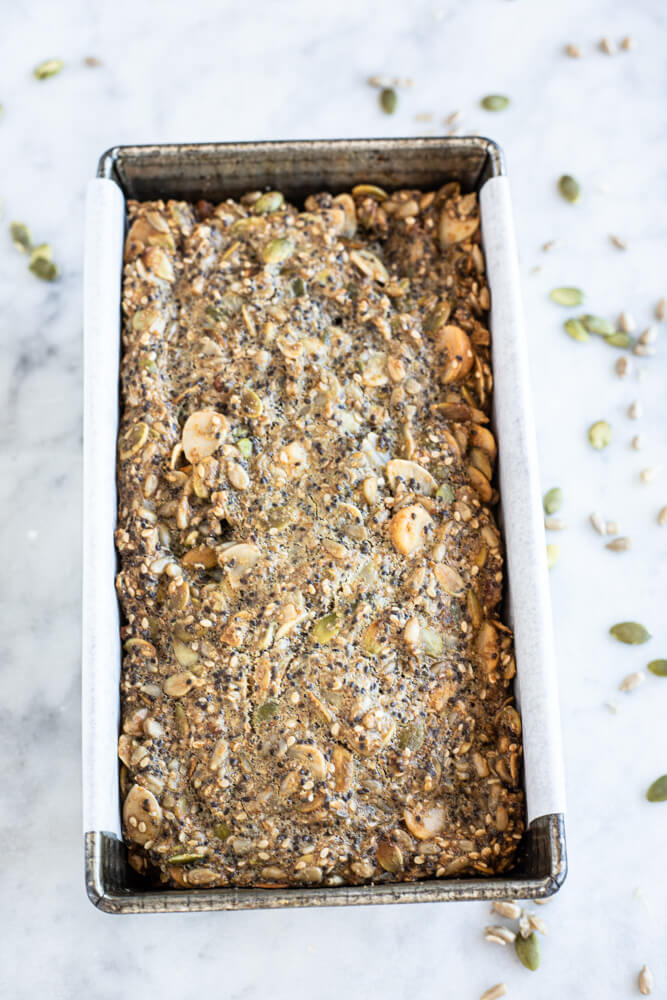 nut and seed bread in a loaf pan