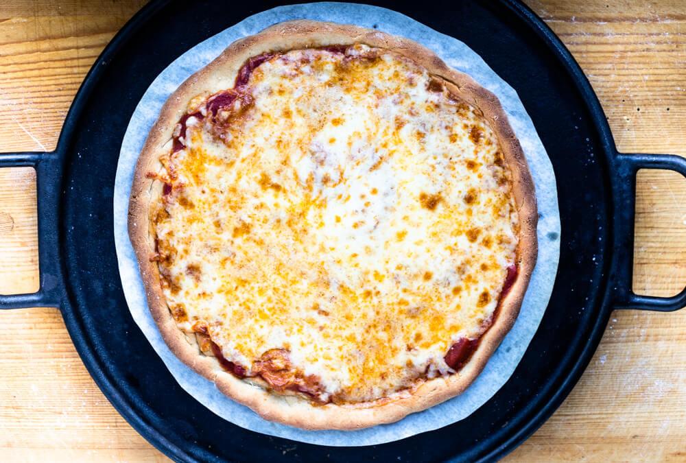 whole gluten free pizza on cast iron pan