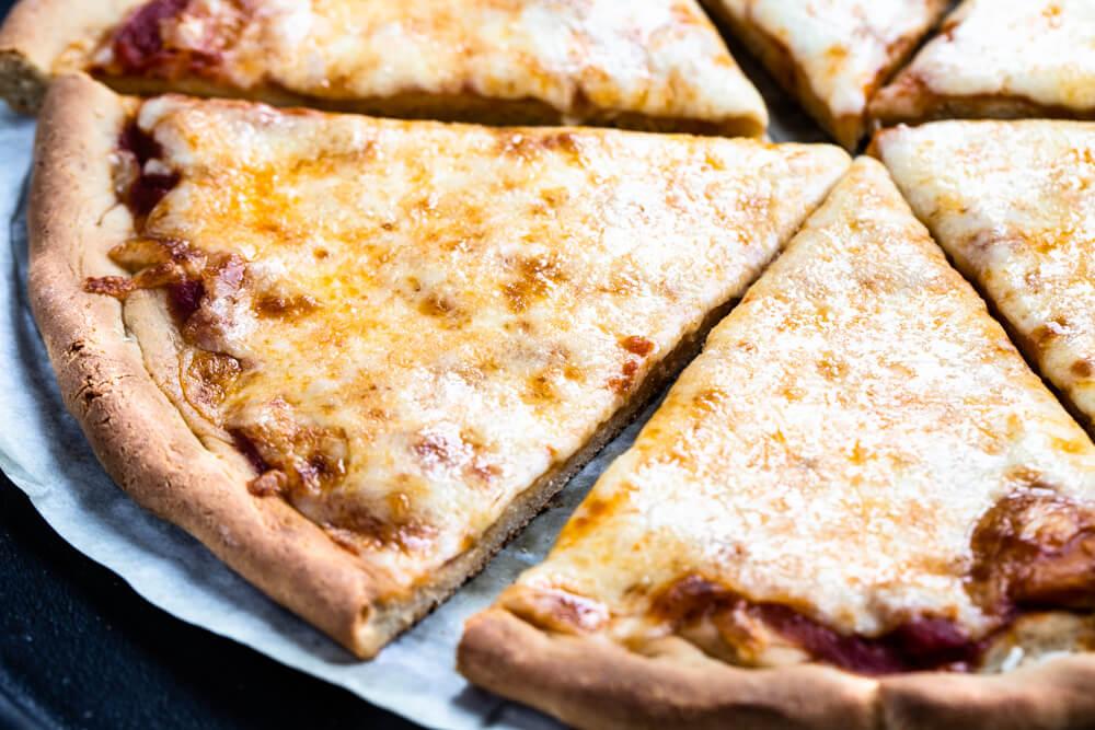 pizza slice on parchment paper