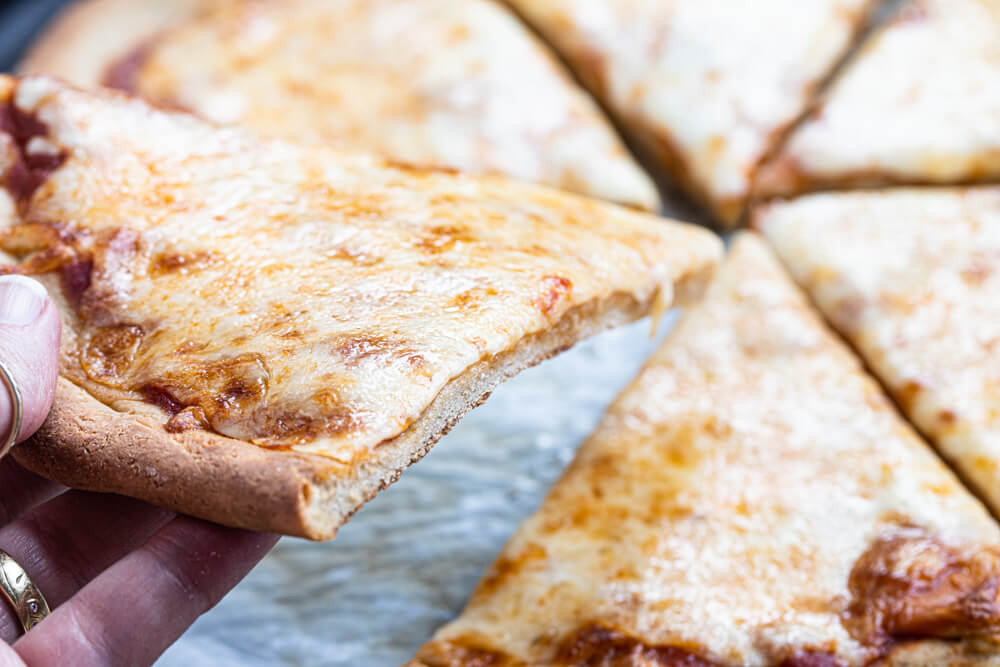 hand holding pizza slice